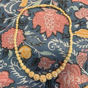 Vintage intricate hand carved bone fetish necklace